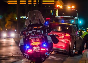 Police respond to a driver involved in a rear-end collision
