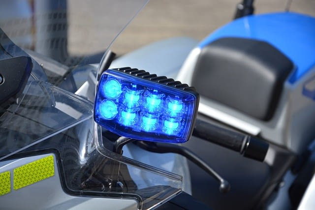 Emergency lights activated on a CHP motorcycle.